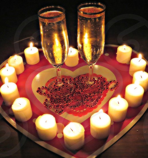 Valentine sparkling wine candles hearts flames love beads photo