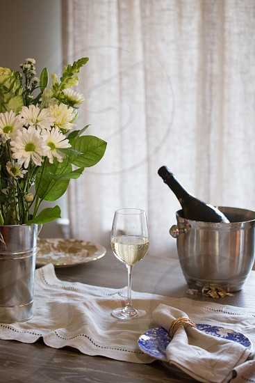 Sparkling wine in a welcoming home setting. Cozy upscale classic rustic home decor wine natural light. photo