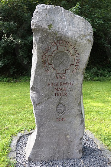 Martental Rhineland-Palatinate / Germany August 30 2017: detailed stone on the pilgrimage path to Trier (Germany). Symbole for an historical path through wild Endert valley and cloister Martental brotherhood of Mayen. photo