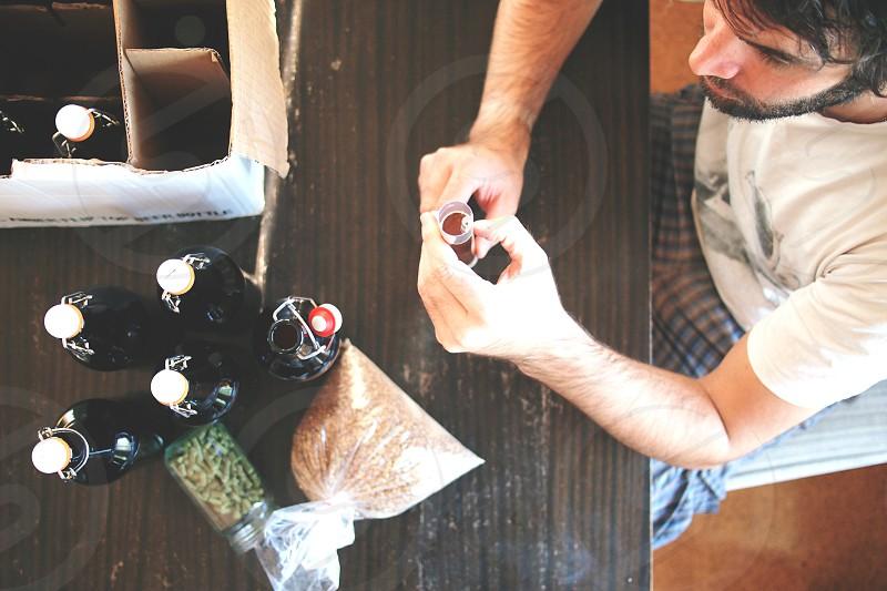 home brewing beer hops grains table beer bottle photo