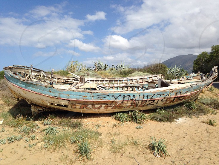 Old decaying wooden boat Greece Crete maritime rotten travel travaling historic holiday wreck wood shore sea ocean beach sunshine sun sunny peaceful island tropical antique coast artistic fisching fischingboat scenic ship desolate art water image geocache geocaching photo