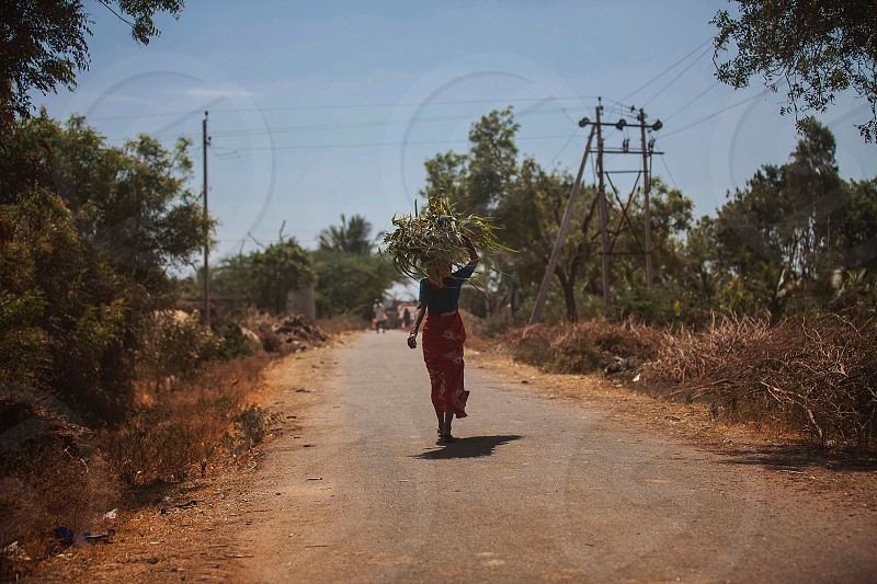 woman walking on road photo