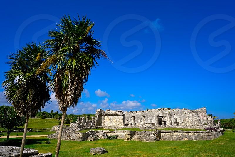 Tulum Mayan city ruins in Riviera Maya at the Caribbean of Mayan Mexico photo
