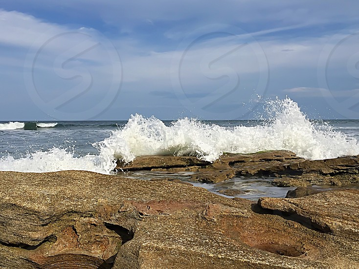 Waves crashing at the beach photo