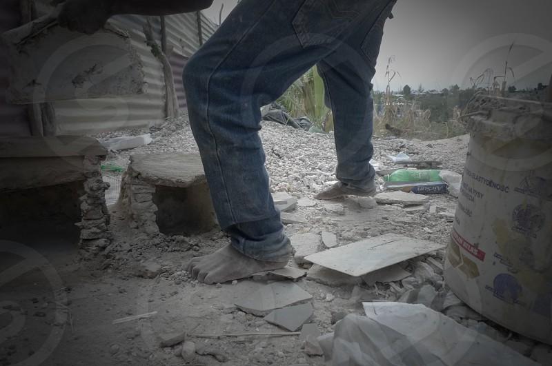 Haiti Bare Feet Buildings Stone Buildings Sand Dirt Jeans Boy Create Build  photo