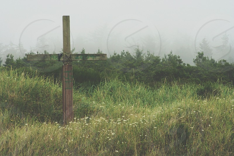 brown cross structure on grassfield photo