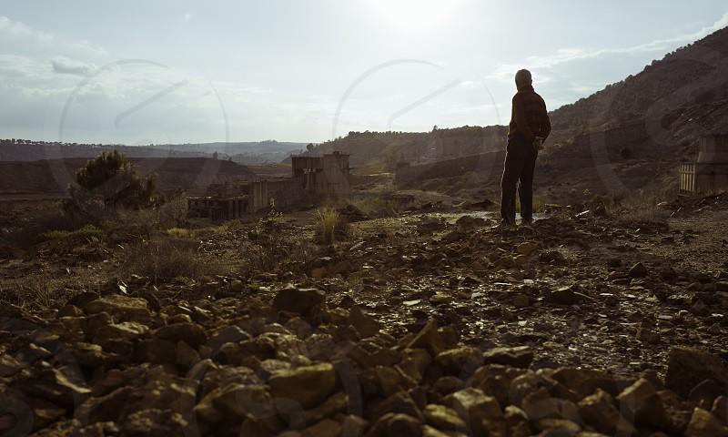 old man looking at the mining ruins photo