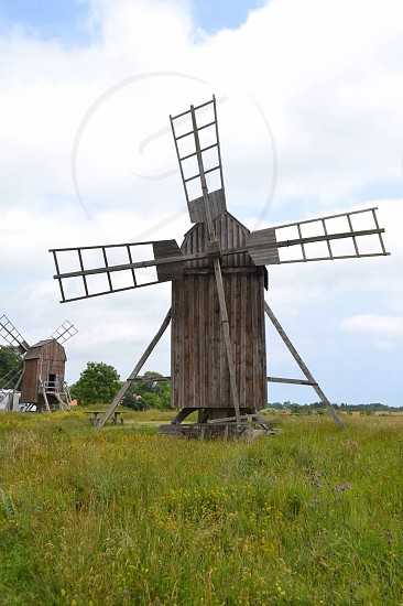 brown windmill on field photo