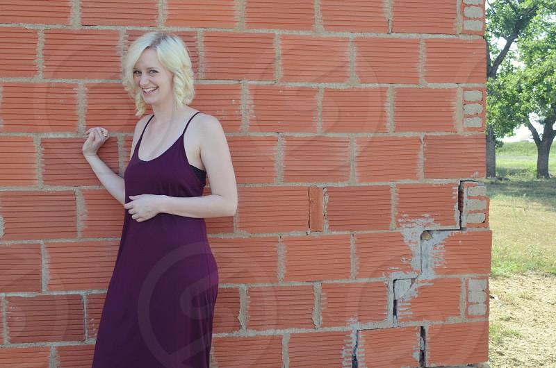 woman smiling wearing purple tank top dress photo