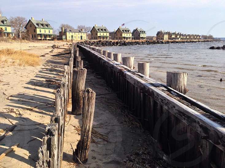 brown wooden fence near sea photo