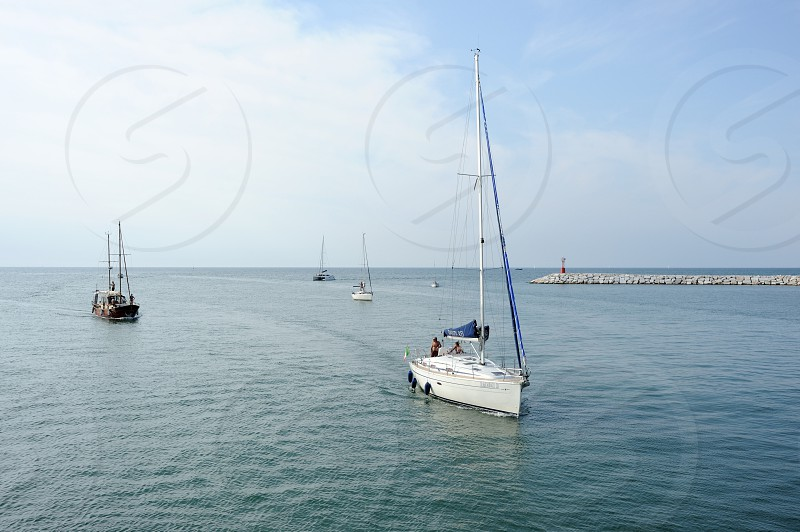 white sailboat on water photo