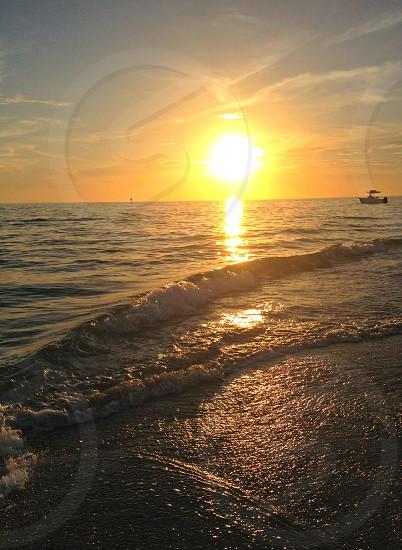 sun setting into the Gulf photo