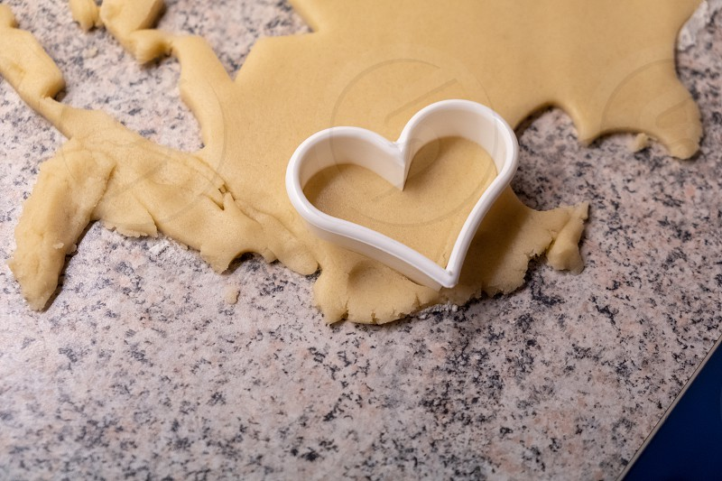 Moulds hearts flour and dough for Christmas biscuits photo