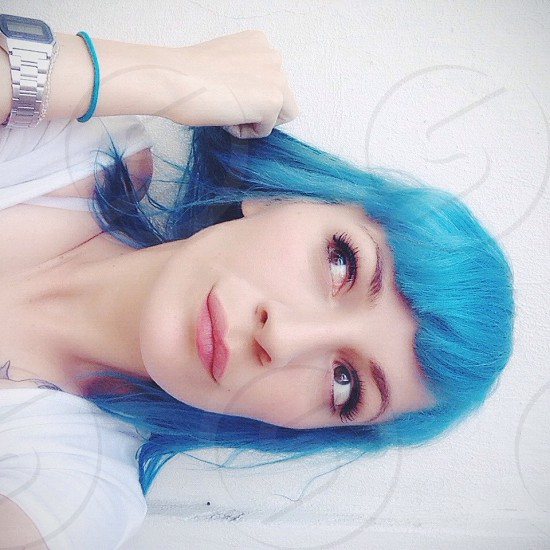 woman with blue hair smiling photo