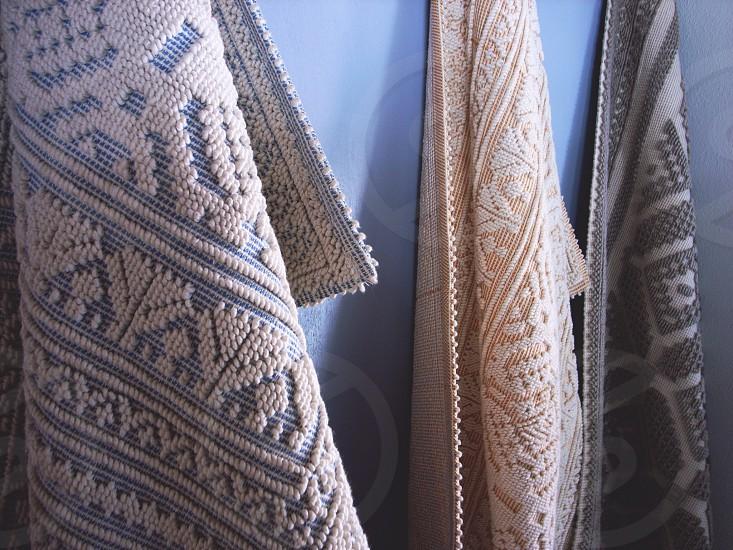 beige hanged textile photo