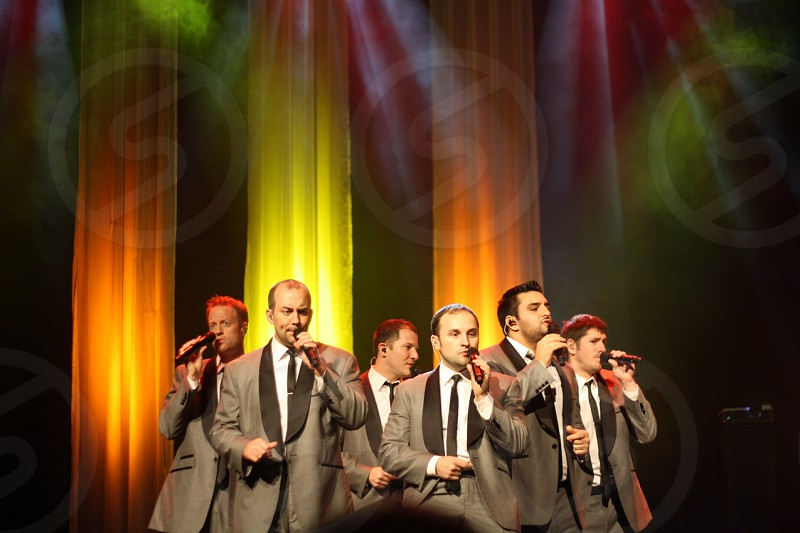 group of men performing on stage photo
