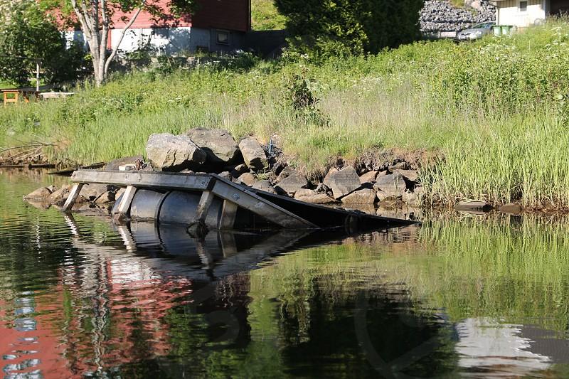 Sad sinking docks in the ocean side photo
