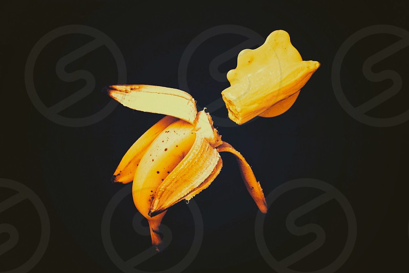 Melted banana yellow color peeled fruits conceptual  photo