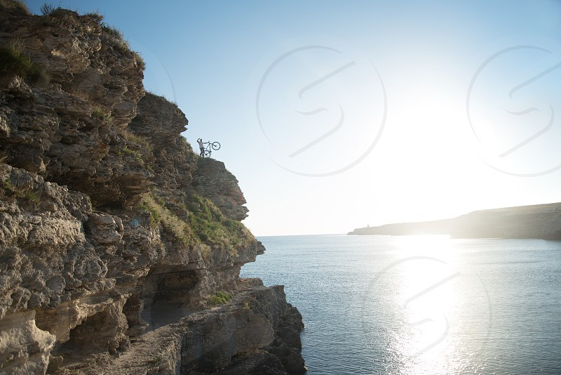 Cyclist on the rock photo