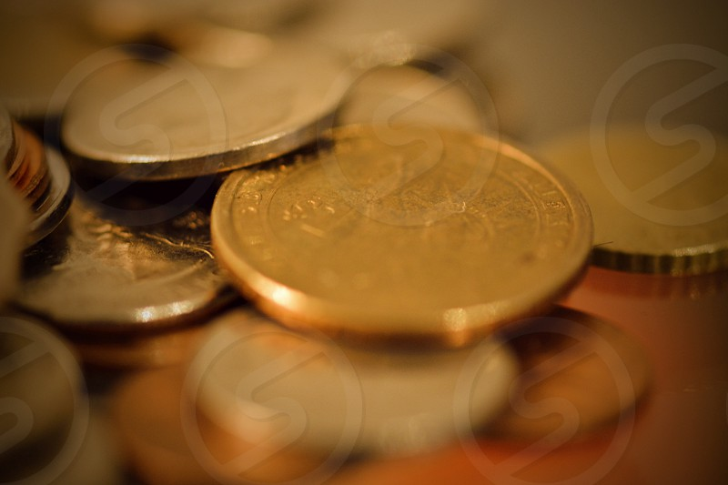brass and silver round coins photo