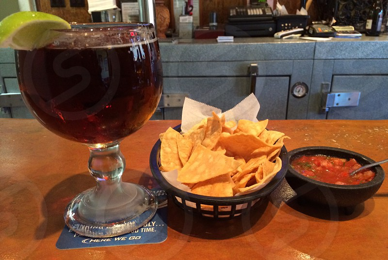 glass goblet and brown nacho chips photo
