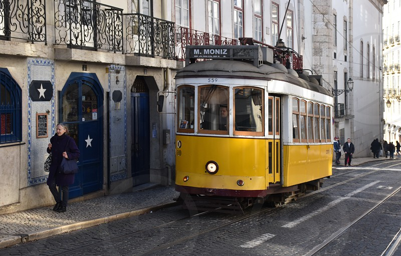 Exploring Lisbon with yellow famous 28 streetcar photo