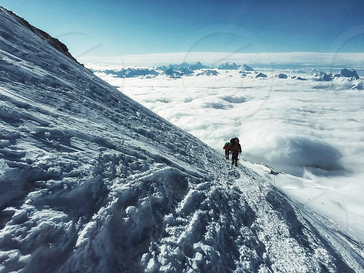 Mountaineers mountain Elbrusclimbing findyourself aboveclouds clouds Sky leapoffaith snow adrenaline. photo