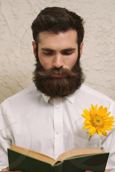 Reading beard flower book photo