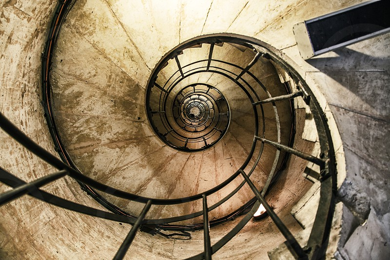 spiral staircase with black steel handrails photo