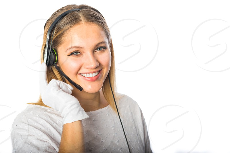 Young woman working as a call center representative wearing white gloves. photo