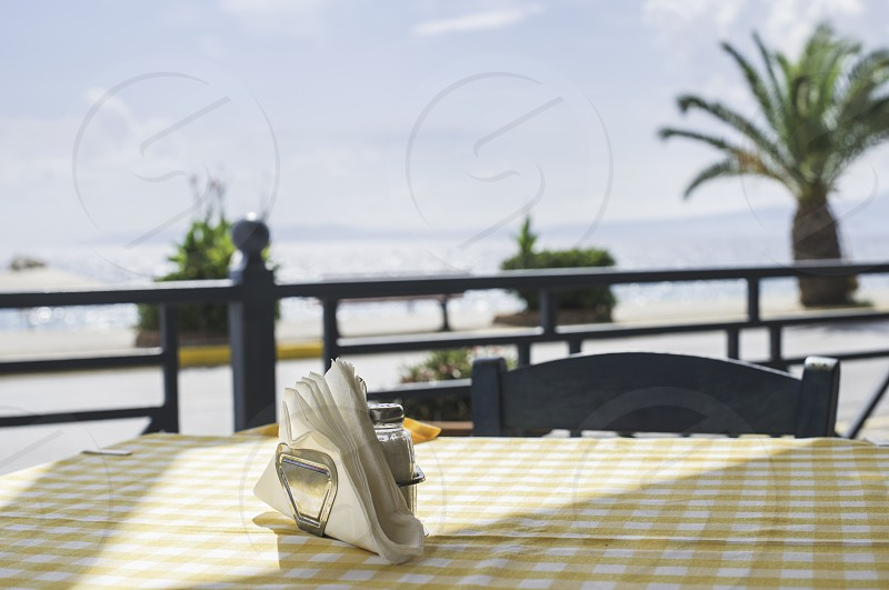 Table in greek restaurant. Day light photo