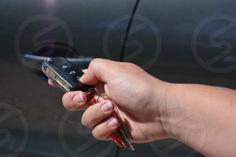 hand with car key keyless remote entry photo