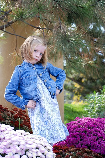 Silly girl among the flowers photo