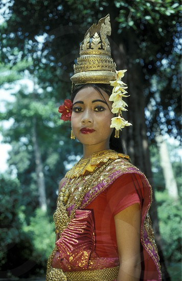 a khmer apsara Dance women at the angkor wat temple in Angkor at the town of siem riep in cambodia in southeastasia.  photo