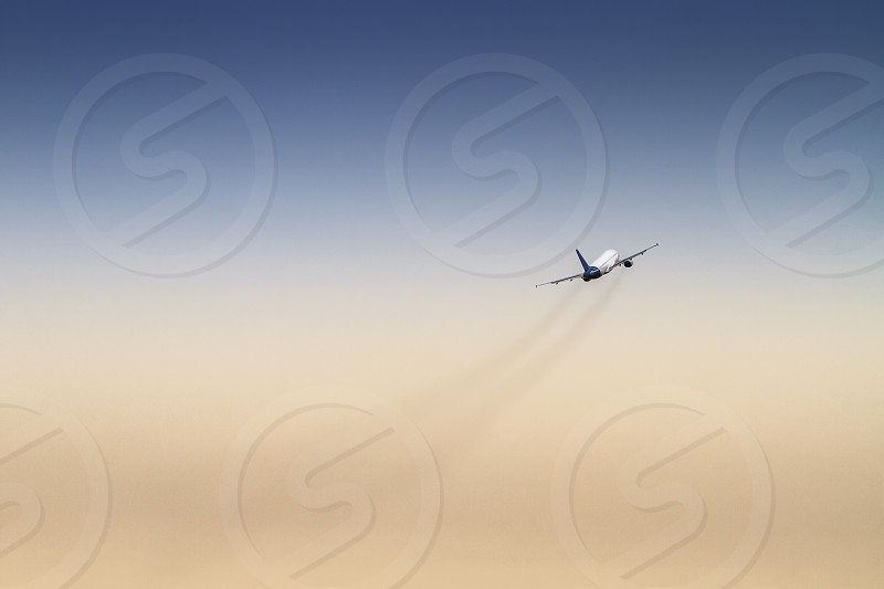 airplane plane sky travel trail thrust takeoff photo