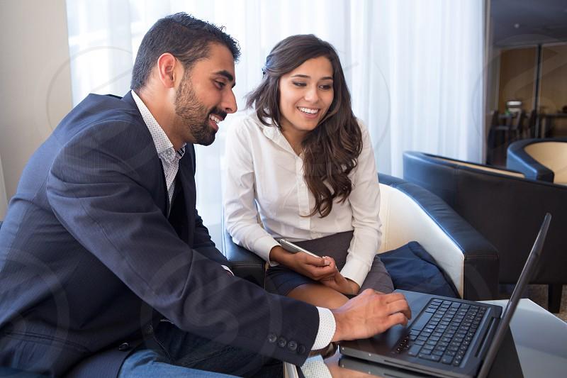 business couple woman man youth latin hispanic laptop tablet photo