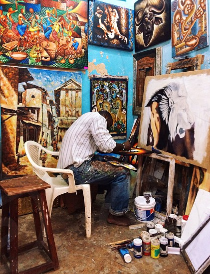 artist painting in a studio photo