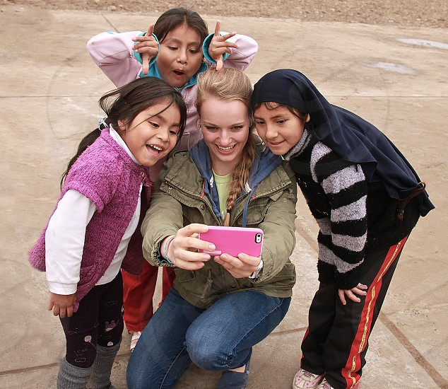 woman and 3 children smiling photo