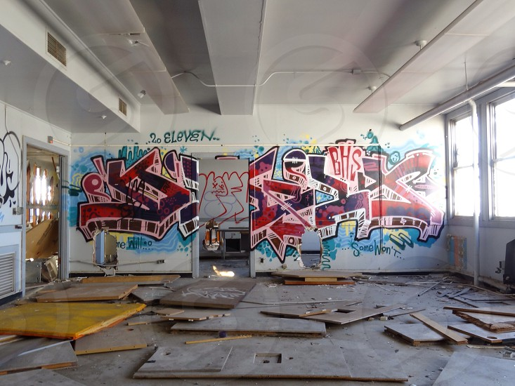 multicolored wall graffiti in empty room photo