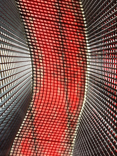 Red bridge with metal grid. photo