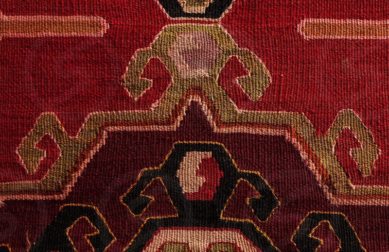 Details of a Serbian blanket traditional colors and embroidery.  photo