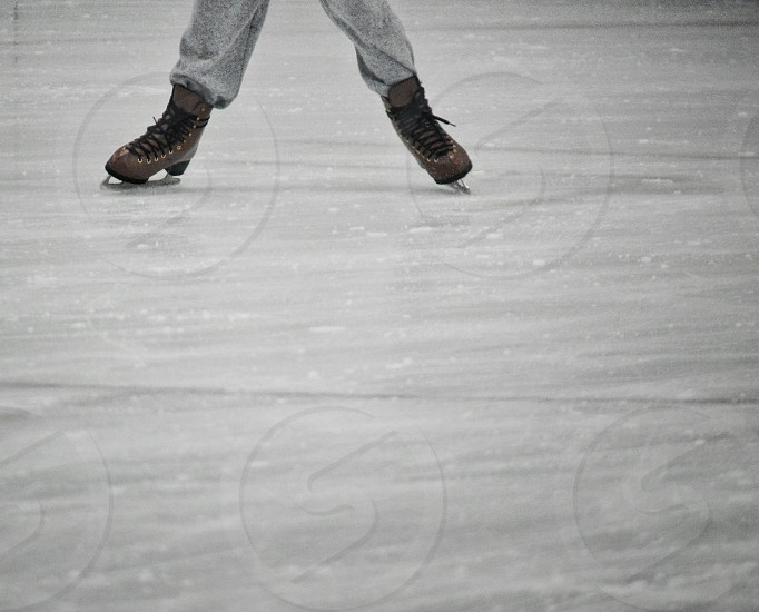 person skating on ice skate ring photo