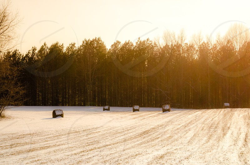 field farm country hay stacks morning glory golden hour light snow open field photo