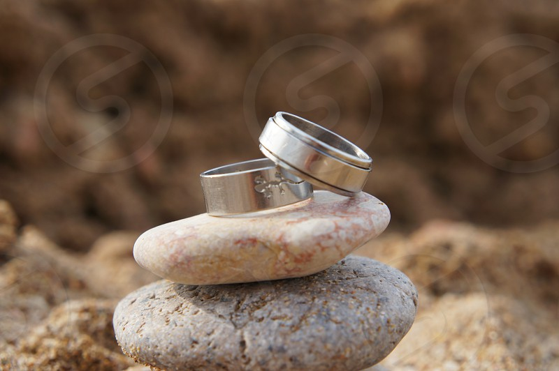 Rings on the beach stones photo