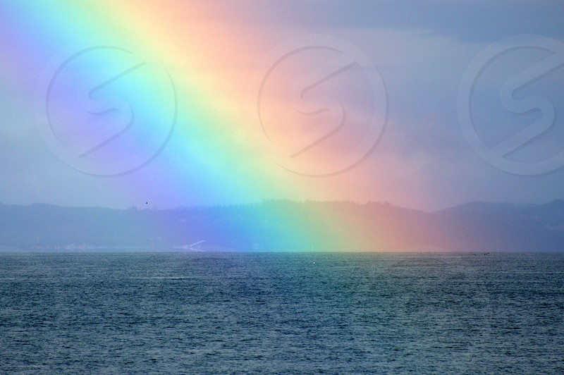 The sea at the end of the rainbow. photo