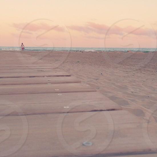 Beach at sunset. Walk sea sand woman photo