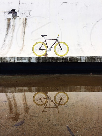 black and yellow fixie bicycle photo