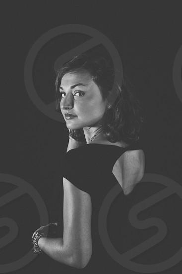 Woman posing in dim lit studio photo