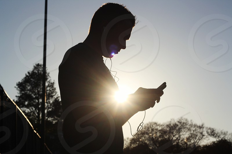 man's silouhette on sunrise photo