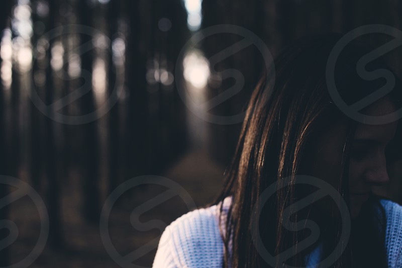 woman in white knitted shirt in selective focus photography photo